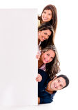 Group of friends with a banner Royalty Free Stock Photo