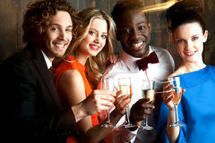 Group of friends at the bar, cheers to all... Group of friends enjoying drinks in restaurant bar Stock Photography