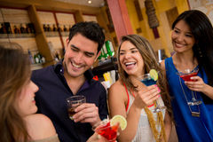 Group of friends at the bar Stock Photos
