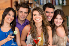 Group of friends at the bar Stock Images