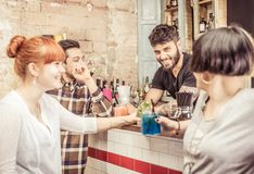 Group of friends in a bar Stock Photography