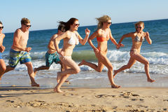 Group Of Friends On Beach Holiday. Group Of Teenage Friends Enjoying Beach Holiday Together stock photo