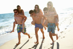 Group Of Friends On Beach Holiday. Group Of Teenage Friends Enjoying Beach Holiday Together royalty free stock photos