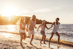 Group of friends on beach stock photography