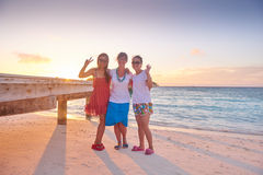 Group of friends on beautiful beach Royalty Free Stock Images