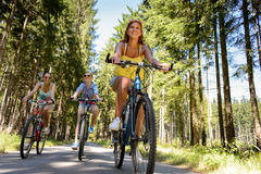 Group of friends on bicycles in countryside Royalty Free Stock Images