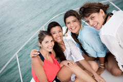 Group of friends in a boat Stock Images