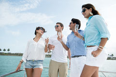 Group of friends on a boat Royalty Free Stock Image