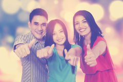 Group of friends with bokeh background Royalty Free Stock Photo