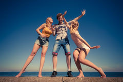 Group friends boy two girls having fun outdoor Royalty Free Stock Photo