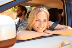 Group Of Friends In Car On Road Trip Together Stock Image