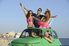 Group of friends with car on vacation Royalty Free Stock Photos