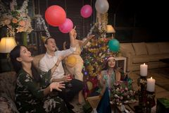 Group of friends celebrate Christmas and New Year together and playing balloons Stock Images