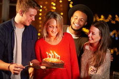 Group Of Friends Celebrating Birthday At Outdoor Party Stock Photo