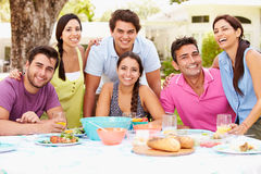 Group Of Friends Celebrating Enjoying Meal In Garden At Home Stock Photos