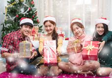 Group of friends celebrating showing gift box royalty free stock photo