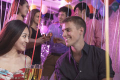 Group of friends celebrating, toasting with champagne, nightclub in Beijing Stock Image