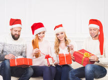Group of friends in Christmas hats celebrating Royalty Free Stock Photo