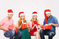 Group of friends in Christmas hats celebrating Royalty Free Stock Photos