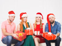 Group of friends in Christmas hats celebrating Stock Photos