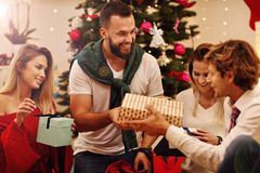 Group of friends with Christmas presents at home Stock Images