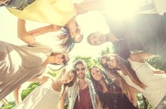 Group of friends in circle. Happy friends making a circle - Group of stidents having fun Royalty Free Stock Photos