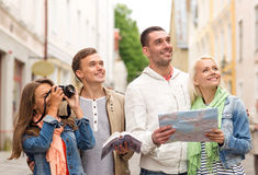 Group of friends with city guide, map and camera Stock Image