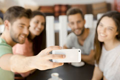 Group selfie at the coffee shop. Group of friends at the coffee shop making a selfie together Stock Photos