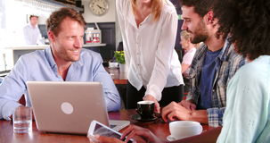 Group Of Friends In Coffee Shop Using Digital Devices stock video footage