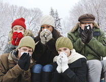 Group of friends with colds outside in winter Royalty Free Stock Photography