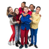 Group of friends in colorful clothes standing and Stock Photo