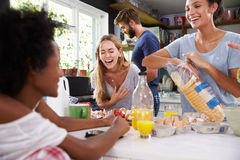 Group Of Friends Cooking Breakfast In Kitchen Together Royalty Free Stock Photography