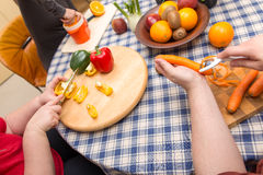 Group of friends are cooking together Stock Photos
