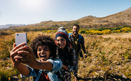 Group of friends on country hike taking selfie Royalty Free Stock Images
