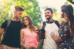Group of friends or couples having fun with photo camera Royalty Free Stock Images