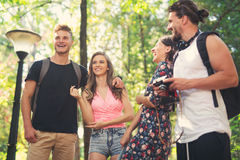 Group of friends or couples having fun with photo camera Stock Image