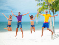 Group of friends or couples jumping on the beach Royalty Free Stock Photos
