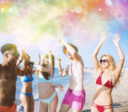 Group of friends dance under a color splash. Of powder Stock Image