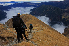Group of friends descending of the mountain Royalty Free Stock Photo