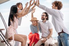 Friends making party on a yacht, having a fancy party on a luxury boat Stock Image