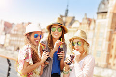 Group of friends drinking cocktails in the city Stock Photo