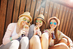 Group of friends drinking cocktails in the city Stock Image