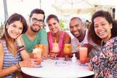 Group Of Friends Drinking Cocktails At Outdoor Bar Royalty Free Stock Photos