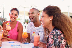 Group Of Friends Drinking Cocktails At Outdoor Bar Stock Images
