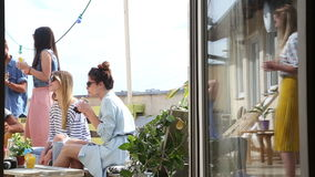 Group of friends drinking and having fun at rooftop party stock video