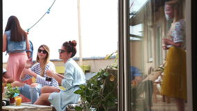Group of friends drinking and having fun at rooftop party stock video footage