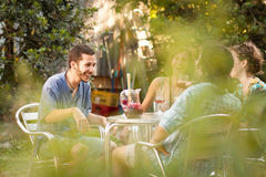 Group of friends drinking and laughing. Group of friends drinking sangria and laughing in a terrace outdoors Stock Images