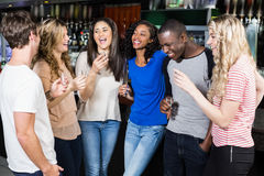 Group of friends drinking shots Royalty Free Stock Photography