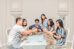 Group of friends drinking and sing song. With guitar at home. Concept about friendship, home entertainment and people stock photo