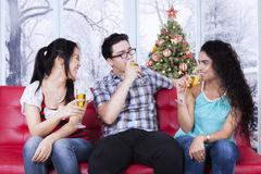 Group of friends drinks champagne together Stock Photos